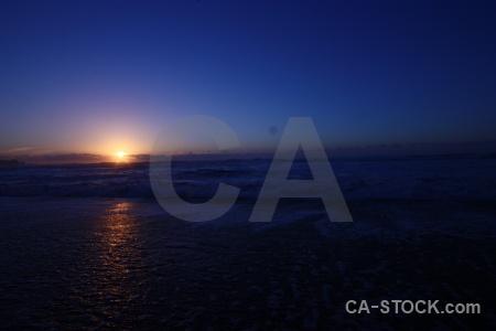 Sunrise sunset sun wave beach.