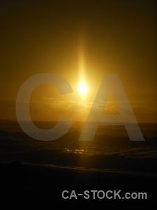Sunset water sun sea beach.