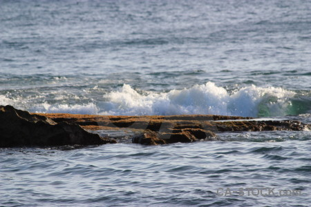 Surface wave sea rock water.