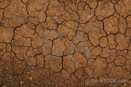 Texture orange crack soil brown.