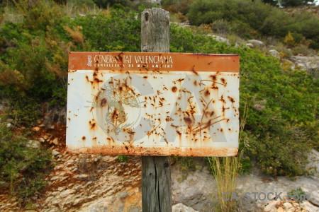 Texture sign green rust orange.