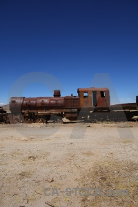 Train bolivia sky south america rust.
