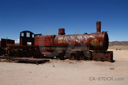 Train cemetery sky south america rust vehicle.