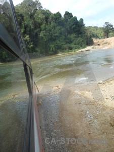 Tree bus river laos vehicle.