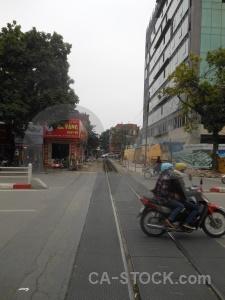 Tree hanoi southeast asia motorbike sky.