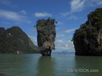 Tropical southeast asia water rock limestone.