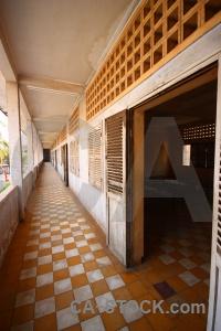 Tuol sleng genocide museum corridor s 21 khmer rouge shutter.