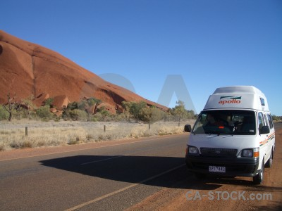 Uluru car rock cliff australia.