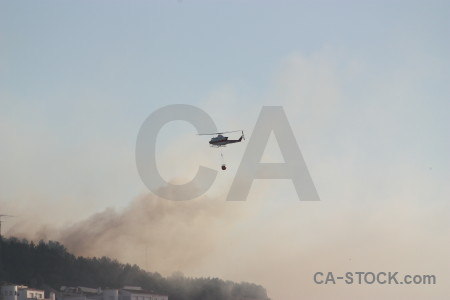 Vehicle firefighting smoke spain helicopter.