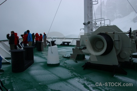 Vehicle foot print boat south pole ice.