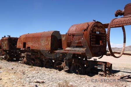 Vehicle uyuni train cemetery rust sky.