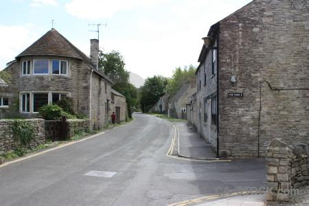 Village white street building.