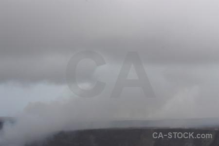 Volcanic crater smoke gray.