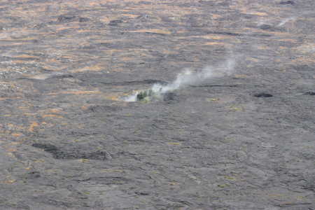 Volcanic gray crater smoke.