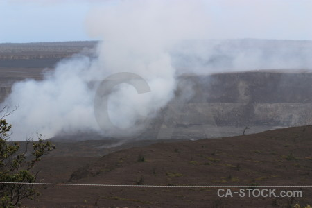 Volcanic landscape crater smoke.