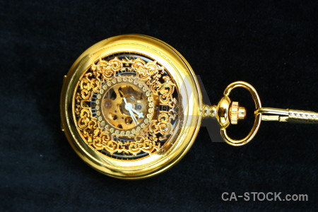 Watch orange black object pocket watch.
