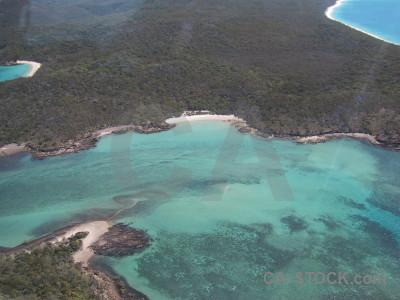 Water aerial island cyan sea.