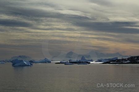 Water antarctica snowcap iceberg cloud.