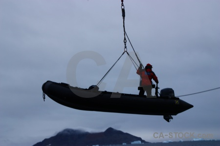 Water crane boat cloud antarctic peninsula.