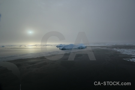 Water fog sun sea ice adelaide island.