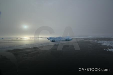 Water fog sun sea ice adelaide island.