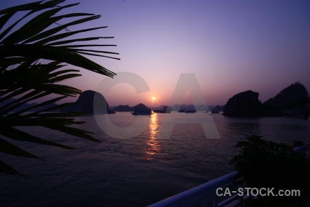 Water ha long bay cliff silhouette sunset.