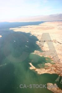 Water lake rock desert mountain.