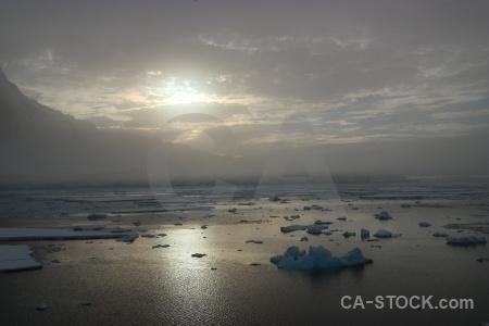 Water reflection ice sun antarctic peninsula.