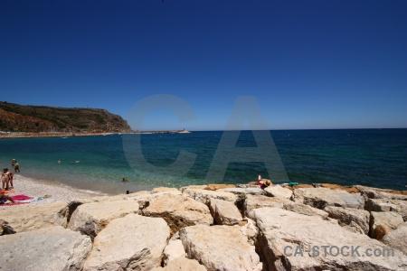 Water sea javea beach rock.