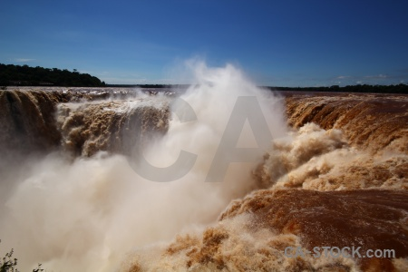 Water spray south america iguazu falls sky.