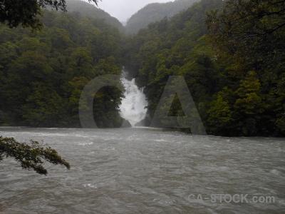 Waterfall haast river tree south island water.