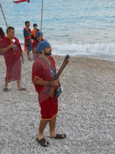 Weapon sea beach stone costume.