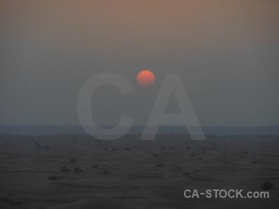 Western asia sky sand sun sunset.