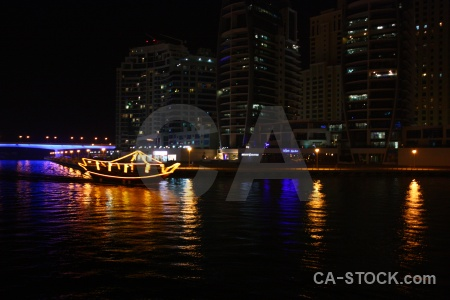 Western asia skyscraper boat night water.