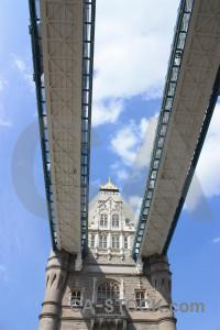 White bridge blue tower building.