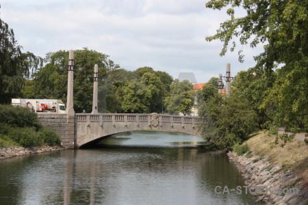 White bridge building green.