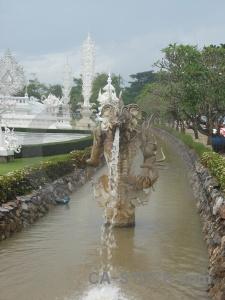 White temple southeast asia tree sky cloud.