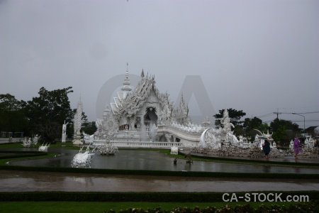 White temple wat rong khun thailand tree pond.